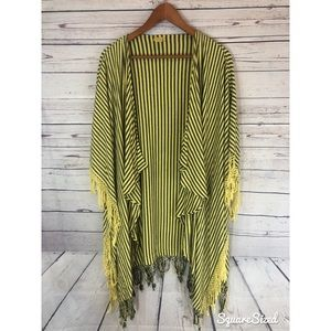 Yellow and black striped festival poncho